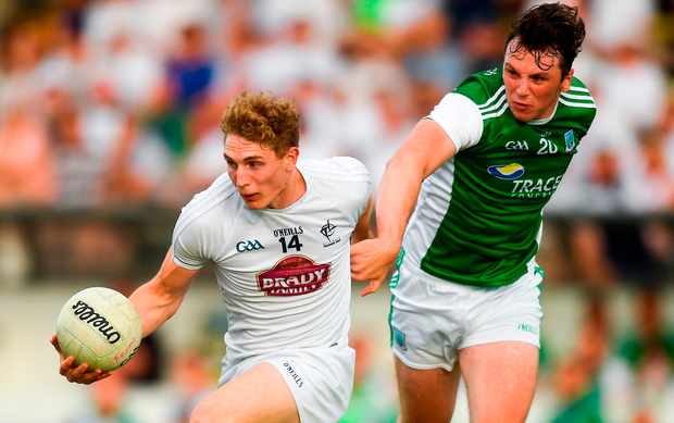 Daniel Flynn of Kildare breaks away from Fermanagh's Tom Clarke during Saturday evening's qualifier in Navan. Photo by Piaras Ó Mídheach/Sportsfile