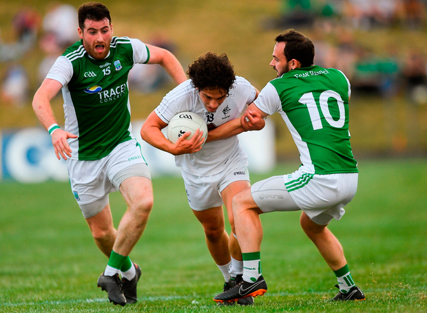 Chris Healy of Kildare in action against Séamus Quigley, left, and Paul McCusker of Fermanagh. Photo by Piaras Ó Mídheach/Sportsfile
