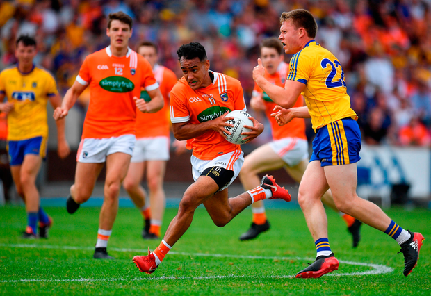 Jemar Hall of Armagh is tackled by Niall Daly of Roscommon. Photo by Brendan Moran/Sportsfile