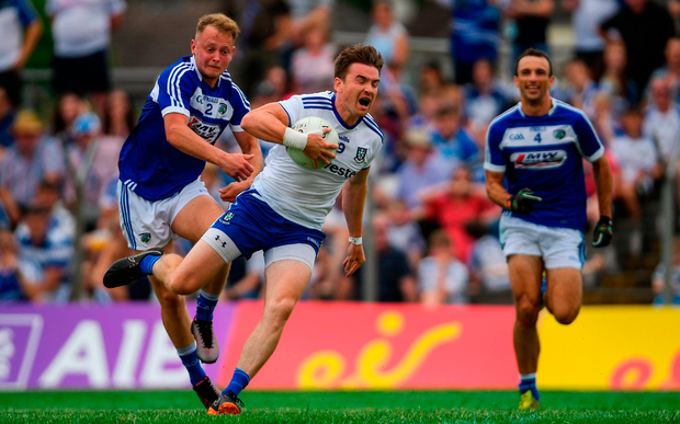 Dessie Mone of Monaghan is tackled by Damien O'Connor of Laois. Photo by Ramsey Cardy/Sportsfile
