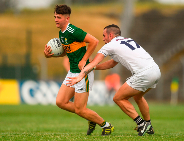 Lee Donoghue of Kerry in action against Mark Grace of Kildare. Photo by Piaras Ó Mídheach/Sportsfile