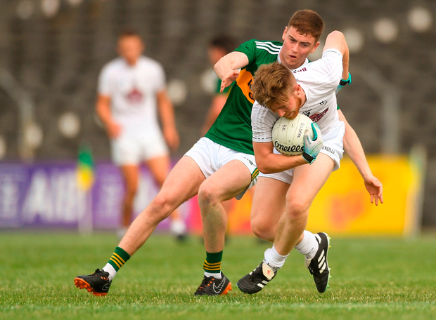 Nathan Sherry of Kildare in action against Ronan Buckley of Kerry. Photo by Piaras Ó Mídheach/Sportsfile