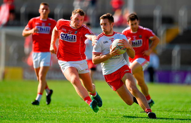 Niall Sludden of Tyrone in action against Brian Hurley of Cork. Photo by Brendan Moran/Sportsfile