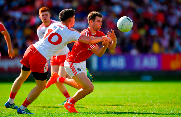 Cian Kelly of Cork in action against Matthew Donnelly of Tyrone. Photo by Brendan Moran/Sportsfile
