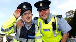 Garda Eddie Fallon with Marc Mullen (13) from Ballyfermot at the Queen concert at Marlay Park. Photo: Damien Eagers