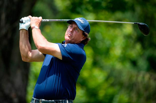 Phil Mickelson tees off the 12th hole during round three of A Military Tribute At The Greenbrier
