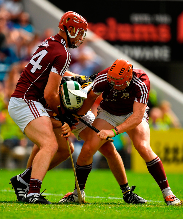 Padraig Walsh of Kilkenny and Jonathan Glynn and Conor Whelan of Galway contest possession. Photo by Brendan Moran/Sportsfile