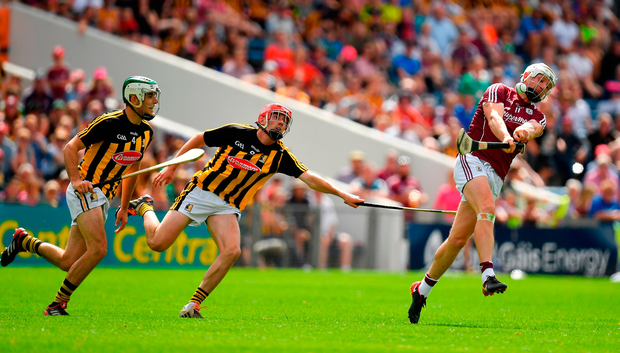 Joe Canning gets a shot away despite the efforts of Paddy Deegan and James Maher. Photo by Brendan Moran/Sportsfile