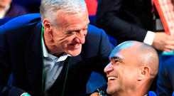 Didier Deschamps and Roberto Martinez share a joke at the draw for the World Cup Finals Photo: FIFA via Getty Images
