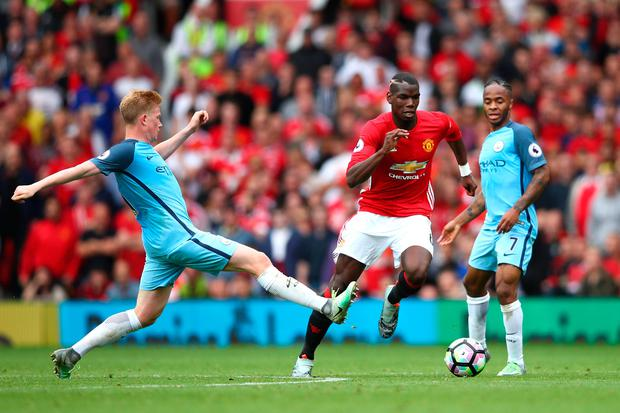The contrast in the licence to create between Kevin De Bruyne and Paul Pogba is stark at international level Photo: Clive Brunskill/Getty Images