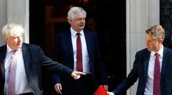 Britain's Foreign Secretary Boris Johnson (L), David Davis (C) and Britain's Defence Secretary Gavin Williamson leave 10 Downing Street in central London after attending the weekly cabinet meeting Photo: Getty Images