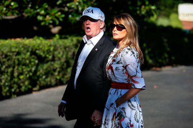 President Donald Trump and first lady Melania Trump cross the South Lawn upon arrival at the White House on July 8, 2018 in Washington, DC. The First Family spent the weekend at the Trump National Golf Club in Bedminster Township, New Jersey. (Photo by Oliver Contreras-Pool/Getty Images)