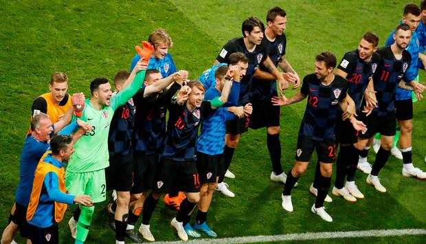 Croatia players celebrate winning the penalty shootout against Russia