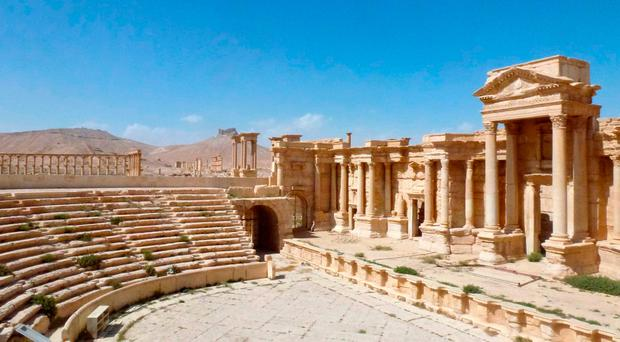 Archaeologists work to repair ancient treasures destroyed by Isil