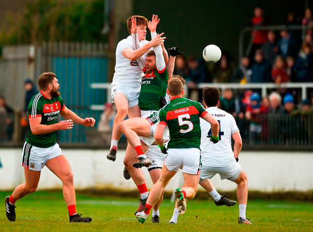 Kevin Feely rises above Aidan O'Shea to win possession during Kildare's victory against Mayo. Photo: Daire Brennan/Sportsfile