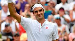 Roger Federer celebrates winning his fourth round match at Wimbledon against France's Adrian Mannarino. Photo:Toby Melville/Reuters