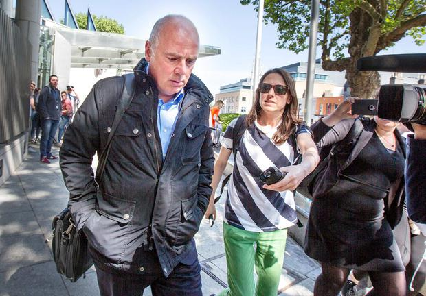 Former Anglo Irish CEO David Drumm leaves the Criminal Courts of Justice. Photo: Tony Gavin