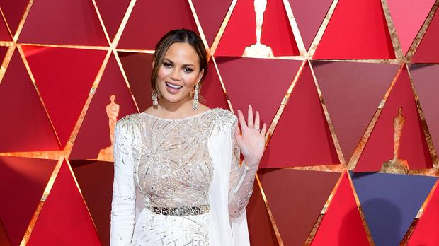 Chrissy Teigen said she was in her car at the time (Ian West/PA)