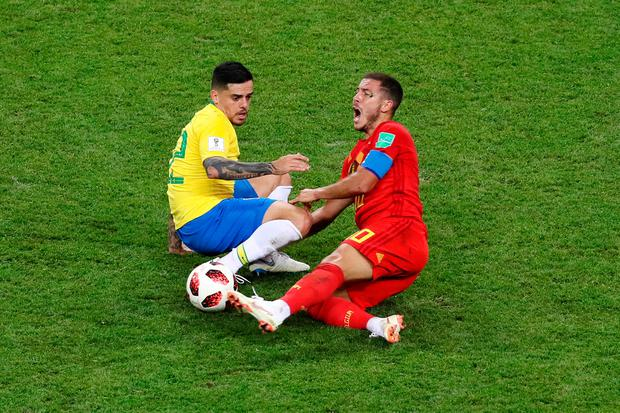 Fagner of Brazil tackles Eden Hazard of Belgium