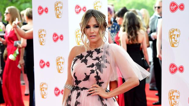 Caroline Flack has split from Andrew Brad (Ian West/PA)