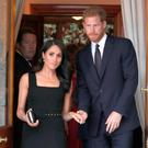 Britain's Prince Harry and wife Meghan, the Duke and Duchess of Sussex attend a Summer AFP PHOTO / POOL / Brian LawlessBRIAN LAWLESS/AFP/Getty Images