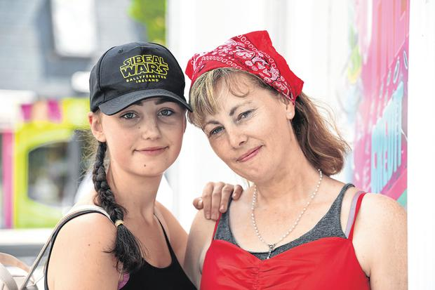Emma Mhic Mhathúna, one of the women affected by the CervicalCheck controversy, and her daughter Natasha (15) at an open-air talk held in Tralee in support of victims of the cancer scandal. Photo: Domnick Walsh