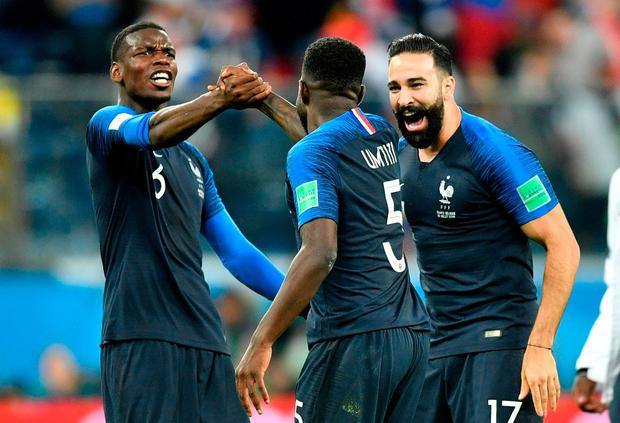 France's Paul Pogba, left, celebrates with Samuel Umtiti and Adil Rami. Photo: Martin Meissner/AP Photo