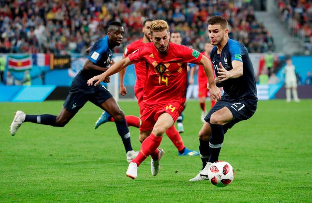Belgium's Dries Mertens in action with France's Lucas Hernandez. Photo: Henry Romero/Reuters