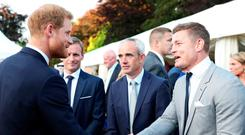 Prince Harry talking with (right) Brian O'Driscoll and (left) Ruby Walsh at the Garden Party in Glencairn, the British Ambassador's Residence .
