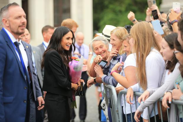 Meghan Markle greets members of the public at Trinity Photo: Gerry Mooney