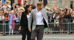 Britain's Prince Harry and Meghan Markle wave to the public at Trinity College Dublin Photo: Gerry Mooney