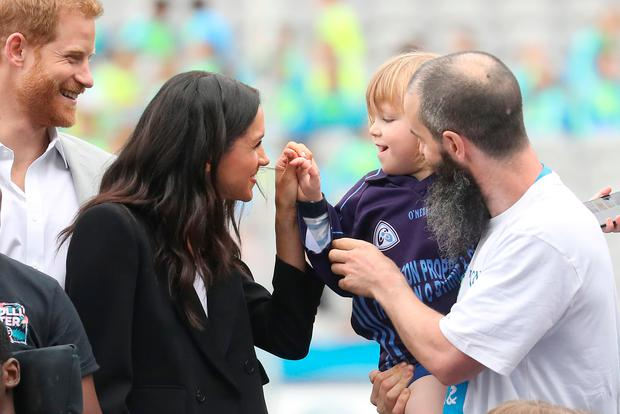 Prince Harry, Duke of Sussex and Meghan meet Walter Kierans, aged 3 at Croke Park (Photo by Chris Jackson - Pool/Getty Images)