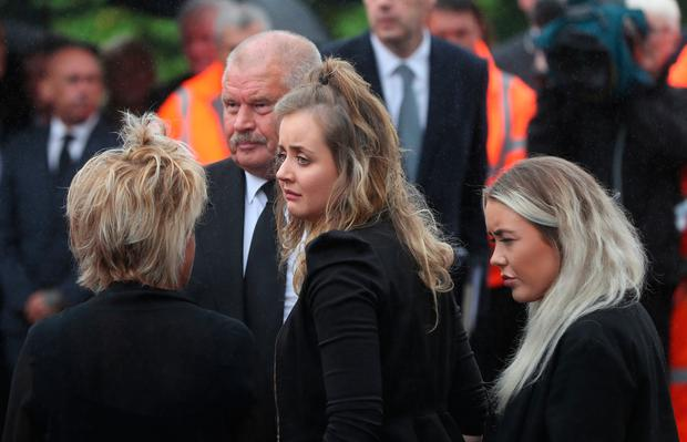 William Dunlop's partner Janine (centre) arrives for his funeral Photo: Niall Carson/PA Wire