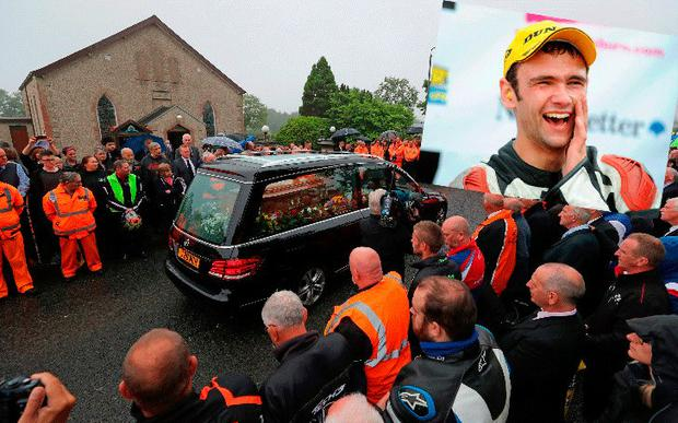 Mourners attend the funeral of Road Racing champion William Dunlop (inset)