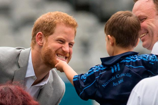 A boy strokes the Duke of Sussex's beard, during a visit to Croke Park, on day two of their visit to Dublin, Ireland. Dominic Lipinski/PA Wire