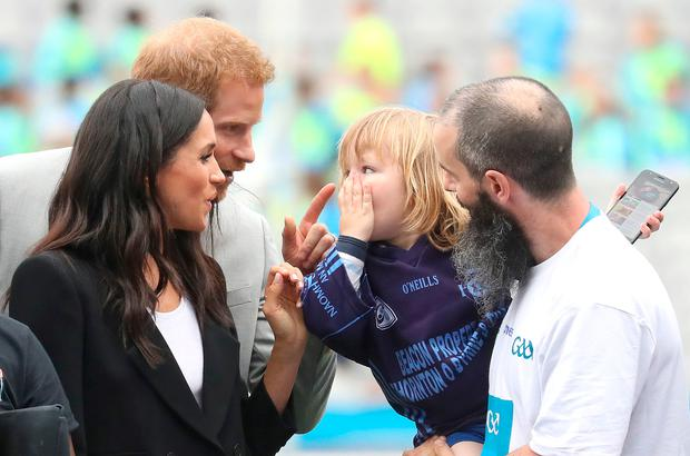 The Duke and Duchess of Sussex meet three year old Walter Kieran as they watch traditional Gaelic sports being played at Croke Park on the second day of their visit to Dublin, Ireland. Chris Jackson/PA Wire