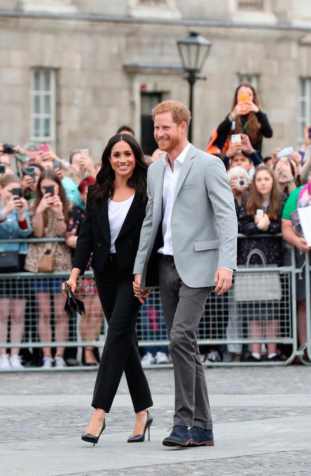 Britain's Prince Harry and Meghan, the Duchess of Sussex walkabout during a visit to Trinity College in Dublin, Ireland, July 11, 2018. Gareth Fuller/Pool via REUTERS