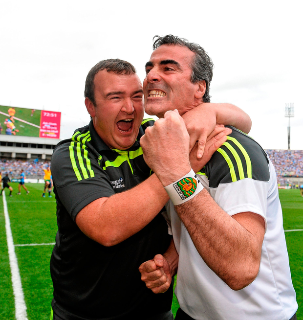 Jim McGuinness celebrates with kitman Joe McCloskey after guiding Donegal to a famous victory over Dublin in the 2014 All-Ireland semi-final. Photo: Sportsfile