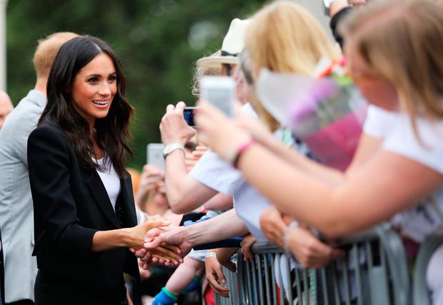 Mindful of the fact that hundreds had waited hours to see her, Meghan spent plenty of time talking to as many people on the streets of Dublin as possible. Photo: Julien Behal