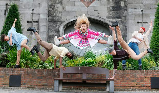 Jade O'Connor of aerial performance company Femme Bizarre with street dance troupe Human Collective at Dublin Castle to launch the Dublin Fringe Festival. Photo: Leon Farrell/Photocall Ireland.