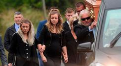 William Dunlop's pregnant partner Janine (left) follows his coffin during the funeral at Garryduff Presbyterian Church near Ballymoney, Co Antrim. Photo: Colm Lenaghan/ Pacemaker