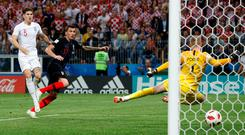 Mario Mandzukic pounces to fire the ball past Jordan Pickford and put Croatia into the World Cup final. Photo: Reuters