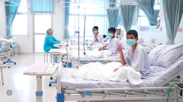 A government video shows three of the 12 boys wearing surgical masks and recovering in an isolation ward after being rescued from the Tham Luang cave complex in the northern province of Chiang Rai. Photo: Thai government/via AP