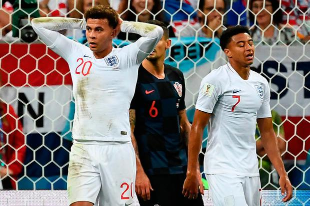 England's midfielder Dele Alli (L) and England's midfielder Jesse Lingard (R) react after a missed chance during the Russia 2018 World Cup semi-final football match between Croatia and England at the Luzhniki Stadium in Moscow on July 11, 2018. / AFP PHOTO / FRANCK FIFE