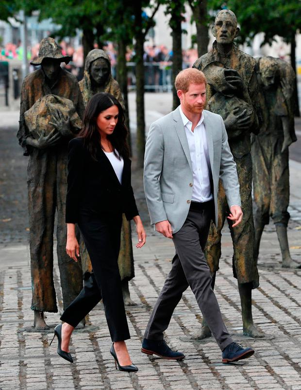 The Duke and Duchess of Sussex at the Famine Memorial, on the second day of their visit to Dublin, Ireland