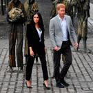 Prince Harry, Duke of Sussex and Meghan, Duchess of Sussex visit the Famine Memorial at Custom House Quay on the second day of their official two day royal visit to Ireland on July 11, 2018 in Dublin, Ireland