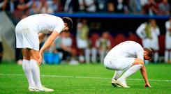 England's Harry Kane (right) and Harry Maguire look dejected at the final whistle after the FIFA World Cup, Semi Final match at the Luzhniki Stadium, Moscow. Wednesday July 11, 2018. Adam Davy/PA Wire.