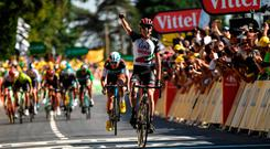 Dan Ireland's Daniel Martin celebrates as he crosses the finish line to win the sixth stage of the 105th edition of the Tour de France
