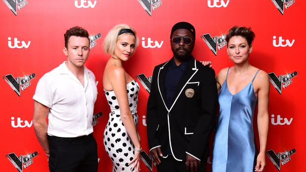 Danny Jones (left), Pixie Lott (second left), Will.i.am, and Emma Willis (right) at the launch of The Voice Kids, at Madame Tussauds in London (Ian West/PA)