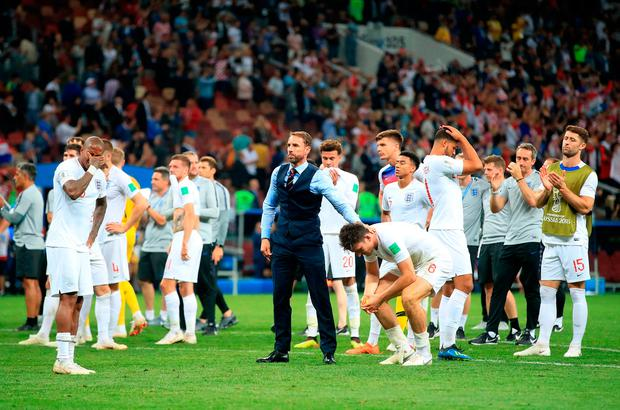 England's Harry Maguire and manager Gareth Southgate after defeat